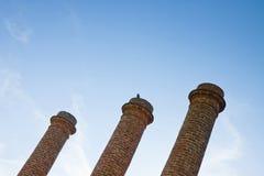 Three old brick chimney isolated on sky Royalty Free Stock Photos