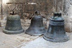 Three old bronze bells Stock Photo