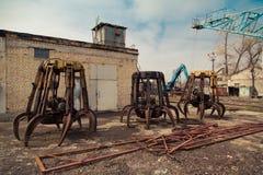 Three old crane grabber. Car dump. stock photo
