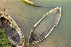 Three old destroyed boats submerged in water near the shore top view royalty free stock images