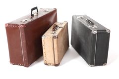 Three old dirty dusty suitcase. isolated. Stock Images