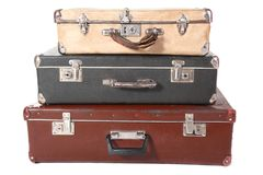 Three old dirty dusty suitcases. All suitcases is closed. Isolated Stock Photo