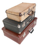Three old dirty dusty suitcases. Isolated. Royalty Free Stock Image