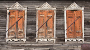 Three old faded wooden windows. With closed shutters Stock Photos