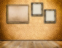 Three old-fashioned frames on wall. stock photos