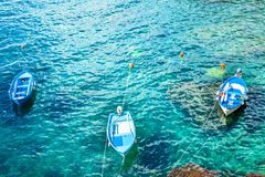 Three old fishing boats in the turquoise waters. Of the Mediterranean Stock Image