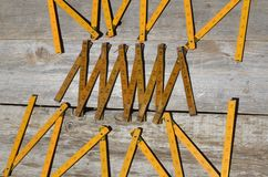 Three old folding rulers. Various wooden folding tape measures displayed in inches Royalty Free Stock Photos