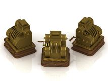 Three old gold-plated cash registers Royalty Free Stock Photo