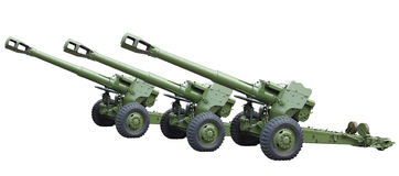 Three old green russian artillery field cannon gun isolated over Royalty Free Stock Images