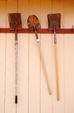 Three old hanging shovels Royalty Free Stock Photo