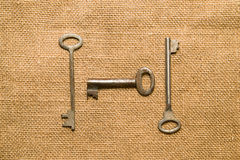 Three  old keys to the safe on a very old cloth Stock Photo