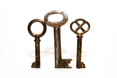 Three old keys to the safe on a white background Royalty Free Stock Photo