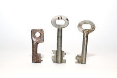 Three old keys on a white background Royalty Free Stock Photography