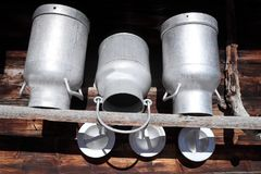 Three old metal milk cans Stock Photos