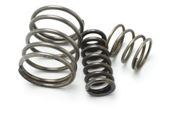 Three old metal springs stock images