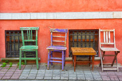 Three old multi-colored chairs Stock Photography