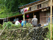 Three old nepalese men sitting beside lodge Stock Photos