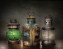 Three Old Oil Lanterns. Three old kerosene rail road type lanterns stock image
