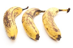 Three old and overripe bananas on white background Royalty Free Stock Images