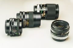 Three old photographic lenses royalty free stock image