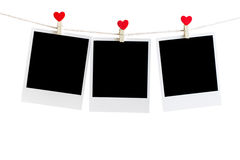 Three Old picture frame hanging on the clothesline over white Royalty Free Stock Photo