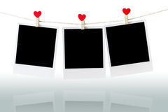 Three Old picture frame hanging on the clothesline over white Stock Photography