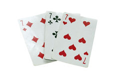 Three old  playing cards, three seven. Stock Image