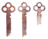 Three old rusty keys on white Royalty Free Stock Photo