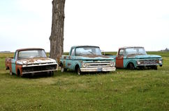 Three old rusty pickups Stock Photo