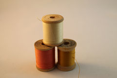 Three Wooden Spools of Thread Royalty Free Stock Photography