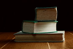 Three old stacked books Stock Photo