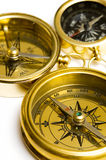 Three old style brass compasses Royalty Free Stock Images