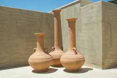 Three old style pots in the desert luxury resort Stock Photo