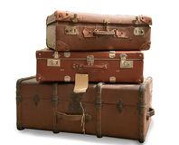 Three old suitcases isolated on white background. Three old suitcases isolated on a white background Royalty Free Stock Image