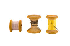 Three old thread spools on white Stock Images