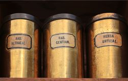 Three old tin cans with medicinal herbs royalty free stock images