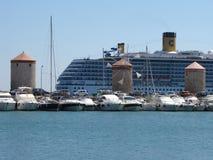 Three old tower in Mandraki harbor. Greece royalty free stock photography
