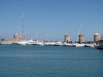 Three old tower in Mandraki harbor photography two. Three old tower in Mandraki harbor, Greece royalty free stock photo
