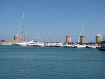 Three old tower in Mandraki harbor photography two Royalty Free Stock Photo