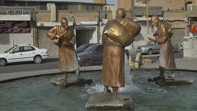 Three old travelers statues in Yazd