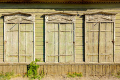Three old vintage windows in traditional Russian Stock Photos