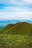 Three old volcano facing wide earth landscape Stock Photo