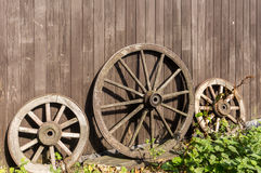 Three old wagon wheels Royalty Free Stock Images
