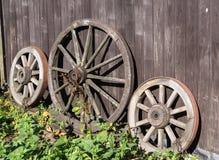 Three old wagon wheels Stock Photo