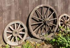 Three old wagon wheels Stock Image
