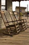 Three old West town empty rocking chairs. Three old West empty rocking chairs sit on wooden sidewalk royalty free stock image