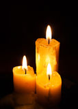 Three old white candles Stock Images