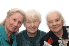 Three old women smiling. Isolated on white background Royalty Free Stock Image