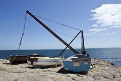 Three old wooden boats on the coast Royalty Free Stock Photos