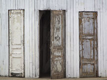Three old wooden doors. One of them is open Royalty Free Stock Photography
